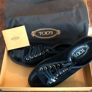 Tod's black and gold sneakers